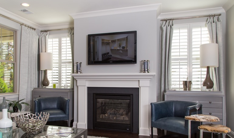 Plantation shutters next to fireplace