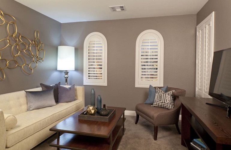 Houston family room with arch plantation shutters.
