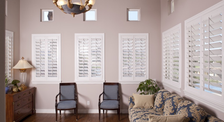 Modern parlor with plantation shutters