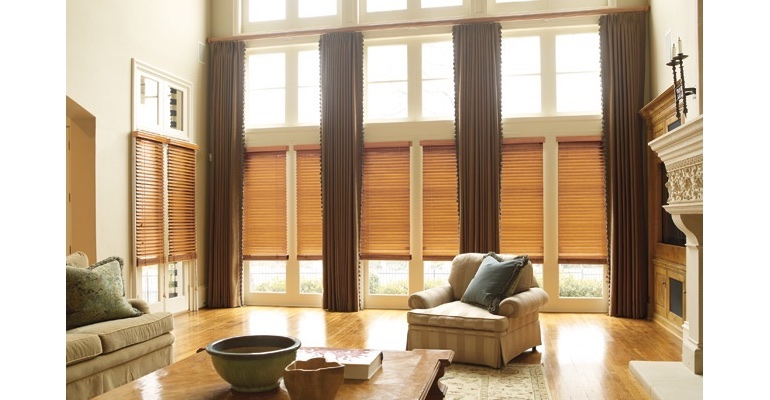 Houston great room with wood blinds and floor to ceiling drapes.