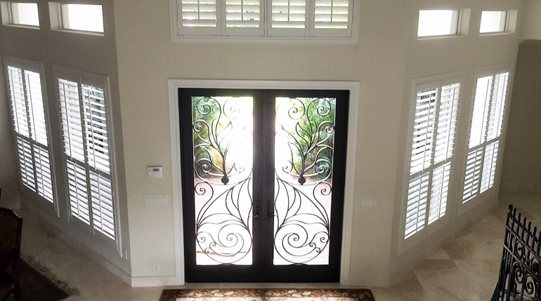 Houston foyer with glass doors and plantation shutters