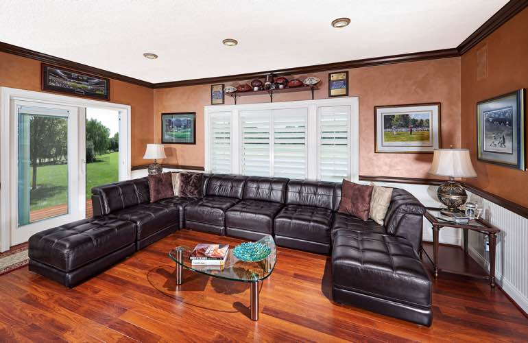 Houston basement with slider doors and plantation shutters.