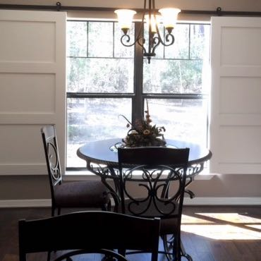 Houston dining room barn door shutters.