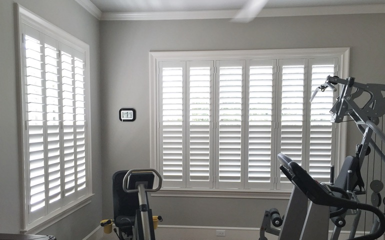 Houston fitness room with shuttered windows.