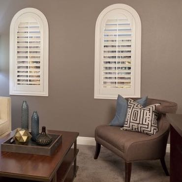 Houston family room arched shutters.