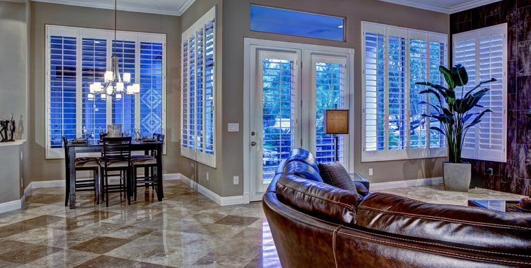 Houston great room with white shutters and leather furniture.