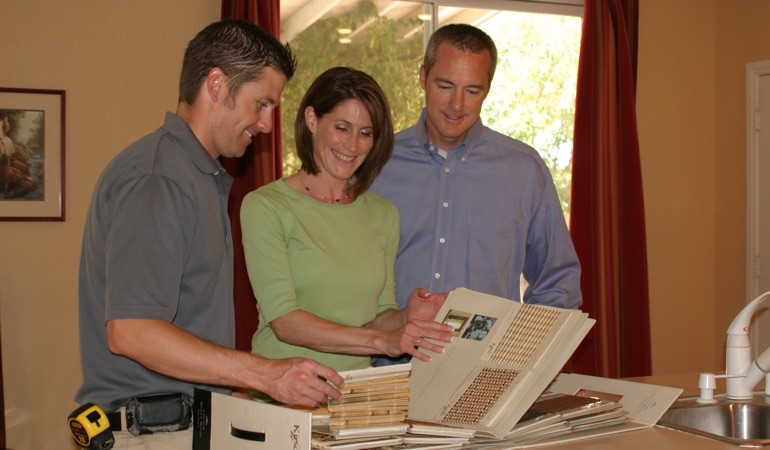 People looking at window treatment samples.