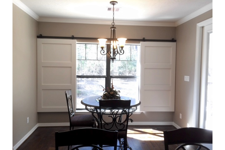 Houston dining room with moveable barn door shutters.