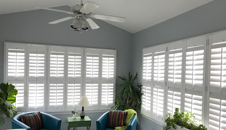 Houston sunroom with fan and shutters