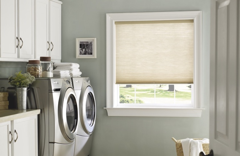 Houston laundry room with tan window shades.