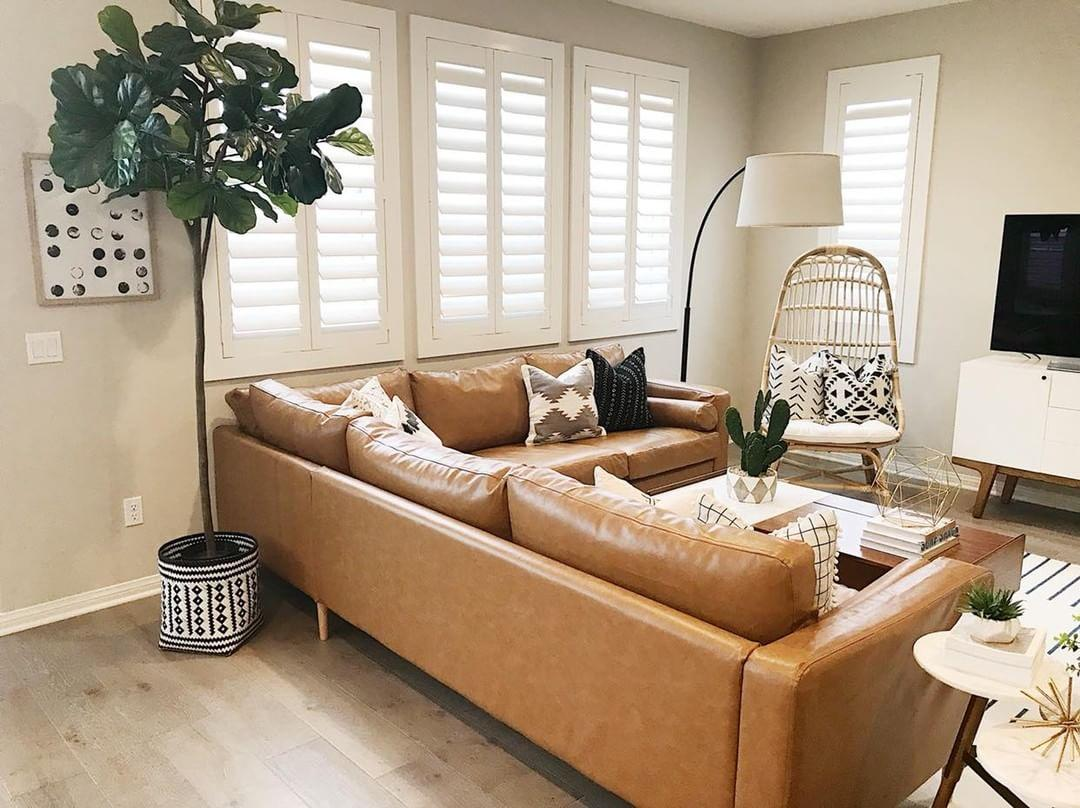 Cozy living room with our Polywood shutters in Houston.