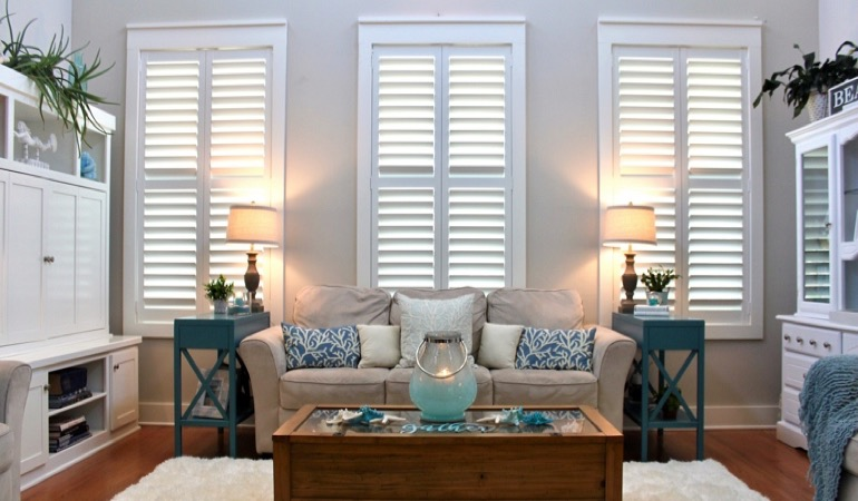 Houston designer living room with chic shutters
