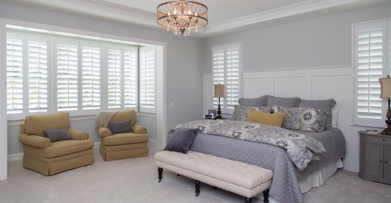 Plantation shutters in Houston bedroom.