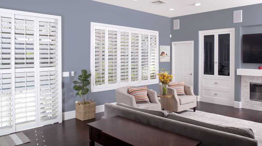 Faux Wood Shutters In pretty Houston Living Room