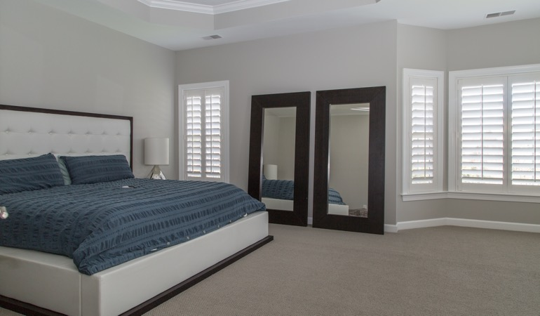 Polywood shutters in a minimalist bedroom in Houston.