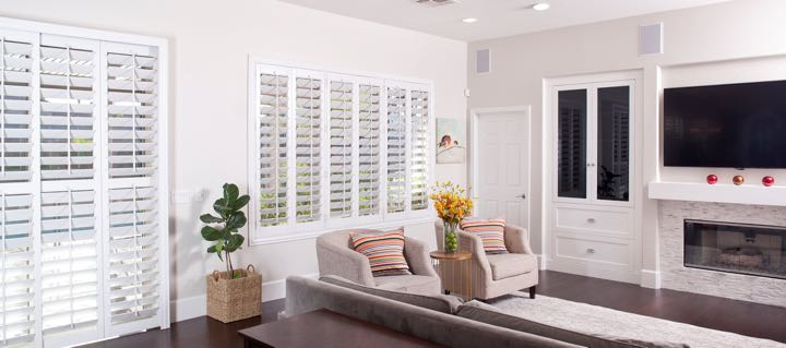 Houston living room in white with plantation shutters.