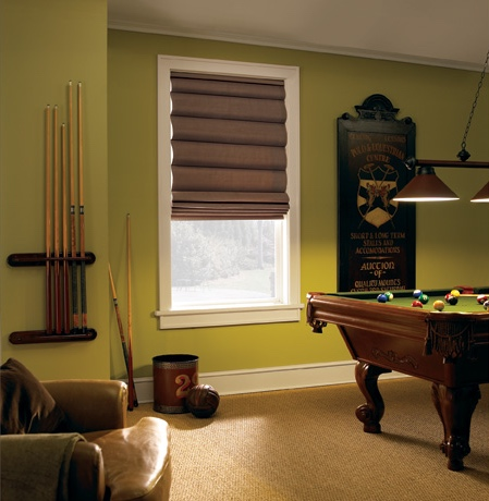 Roman shades in Houston pool room with green walls.