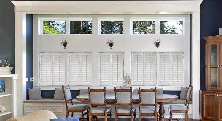 Shut classic plantation shutters in Houston dining room.