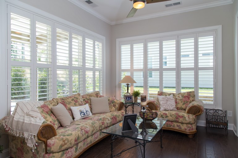 Airy sunroom with interior shutters in Houston.