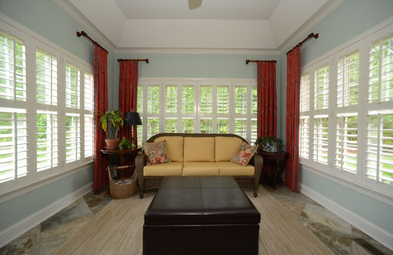 Houston sunroom with plantation window shutters.