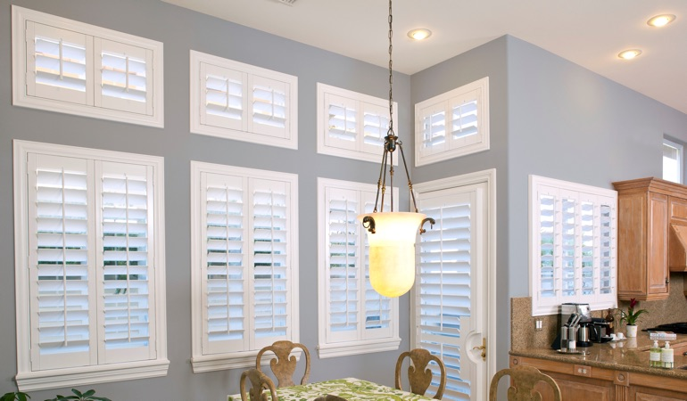 White plantation shutters in kitchen