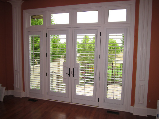 Houston patio door with sidelight shutters