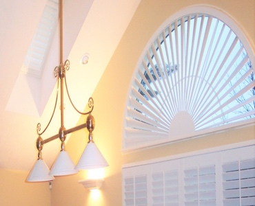 Houston arched eyebrow window with white shutter