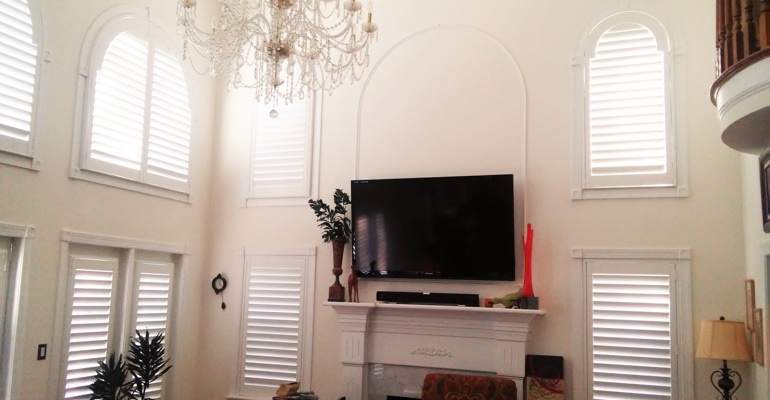 high ceiling windows with shutters Houston tv room