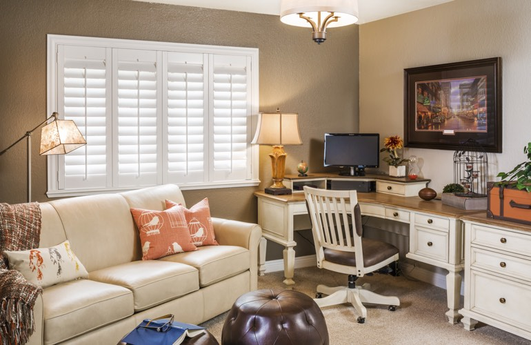 Houston home office with plantation window shutters.
