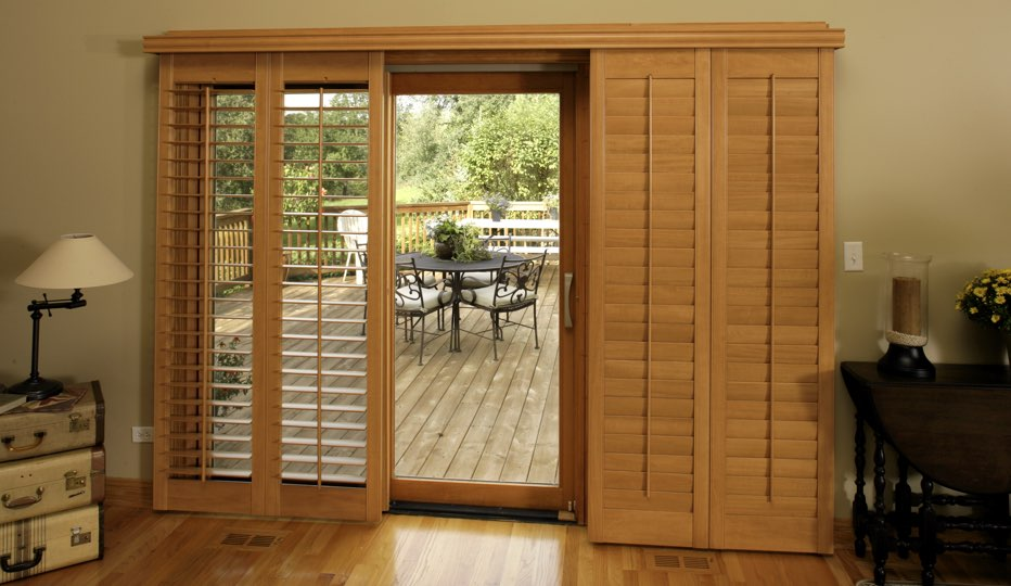 Bypass Wood Patio Door Shutters In A Houston Living Room
