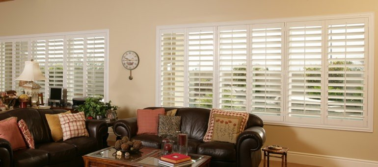 Wide window with plantation shutters in Houston living room